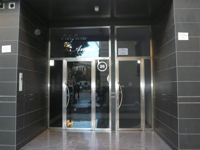 Casmon puertas y escaparates for Puertas de acero inoxidable